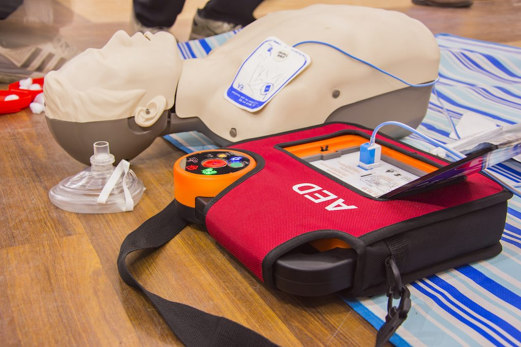 A defibrillator being used during first aid & CPR training